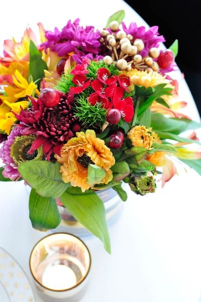 DIY centerpiece ideas for fall and Thanksgiving centerpieces using cranberries in a vase