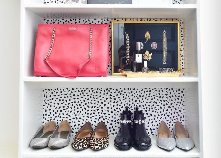 Purse handbag and shoe storage in a master bedroom closet