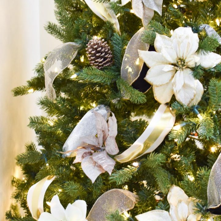 Christmas tree with ribbon and flowers