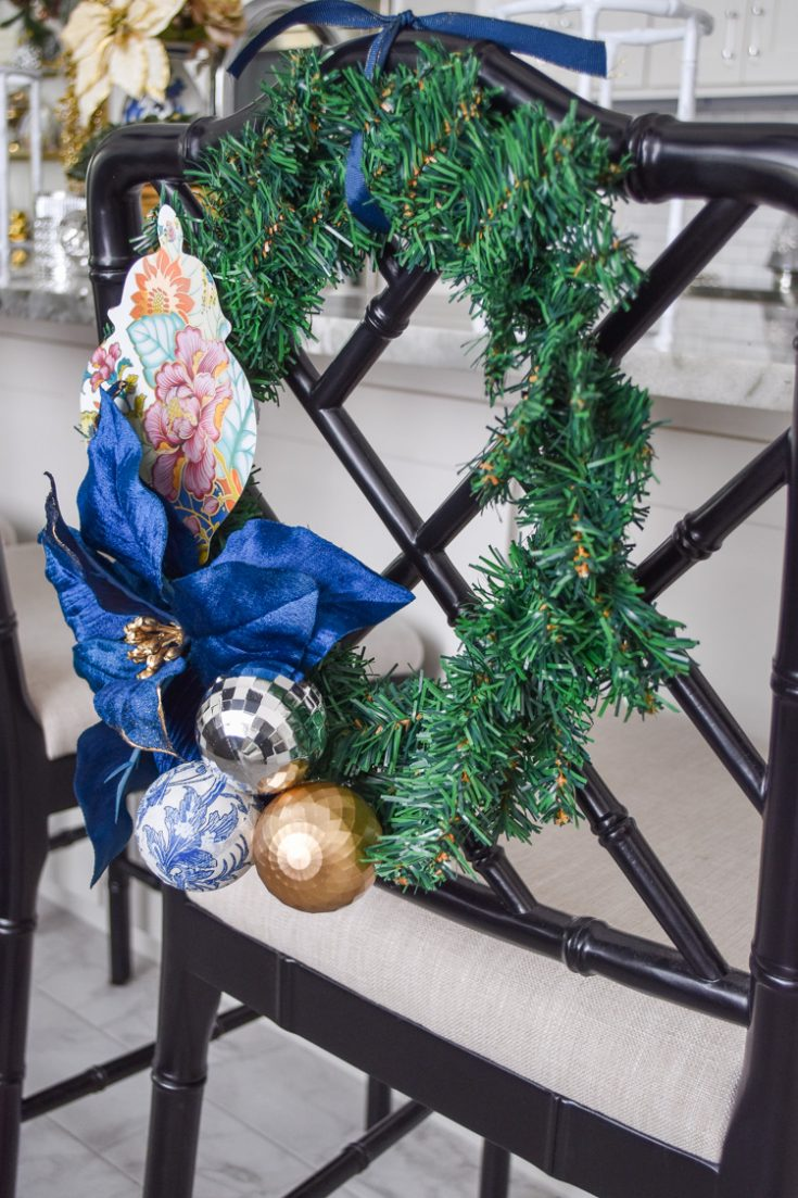 Create simple DIY Christmas wreaths for the back of dining chairs using this easy tutorial! GORGEOUS holiday decor with a chinoiserie chic style that is glam, colorful and bold.