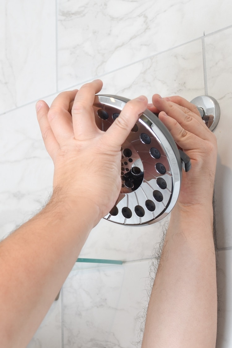 Attaching a new shower head to shower arm