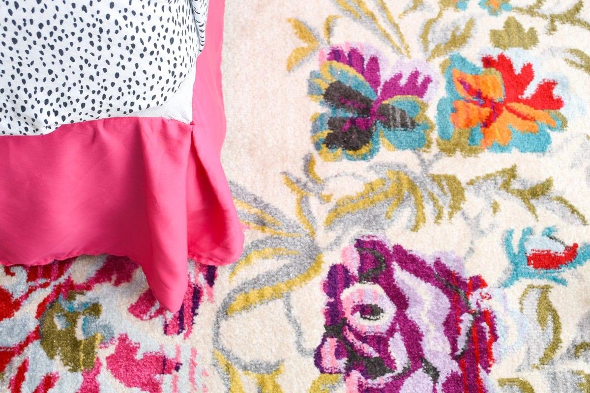 Colorful guest bedroom floral rug