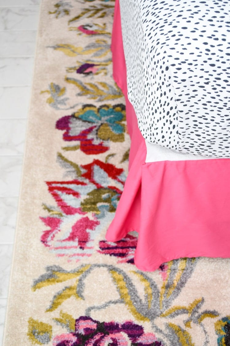 Hot pink bed skirt and floral rug