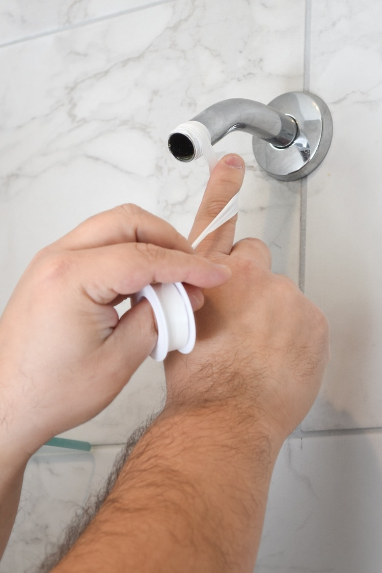 Applying thread seal tape to shower arm