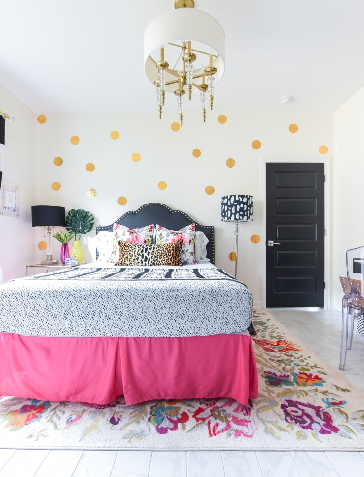 Polka dot accent wall in a guest room