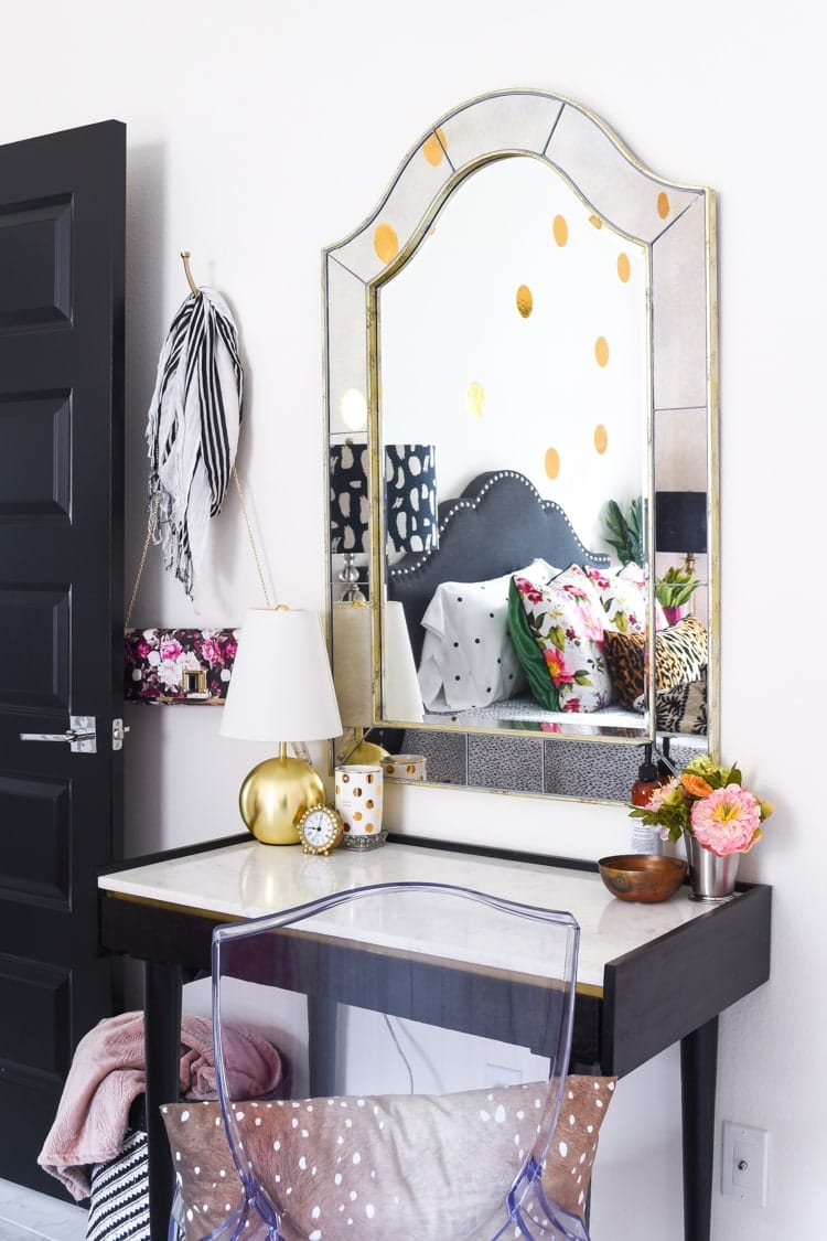 Guest bedroom desk with mirror over it home office