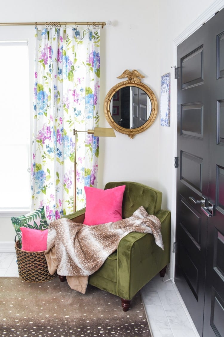 Green chair, pink pillow and vintage eagle mirror decor