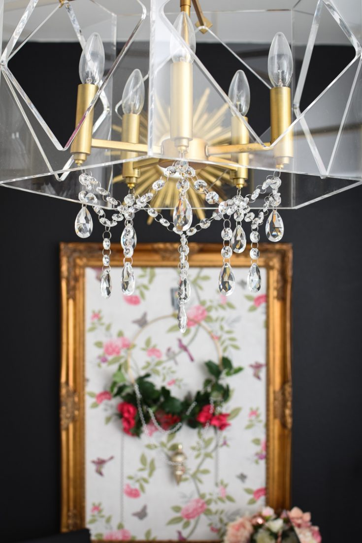 HOW TO ADD CRYSTALS TO A CHANDELIER USING MAGNETS: Update your existing light fixtures on the cheap with this easy DIY tutorial.  #homedecoraccessories #homedecorating #homedecoronabudget #homedecoratingtips #homedecoration #budgetdecorating #office #officedesign #officefurniture #officedecor #officechair #homeoffice #homeofficeideas #interiordesign #interior