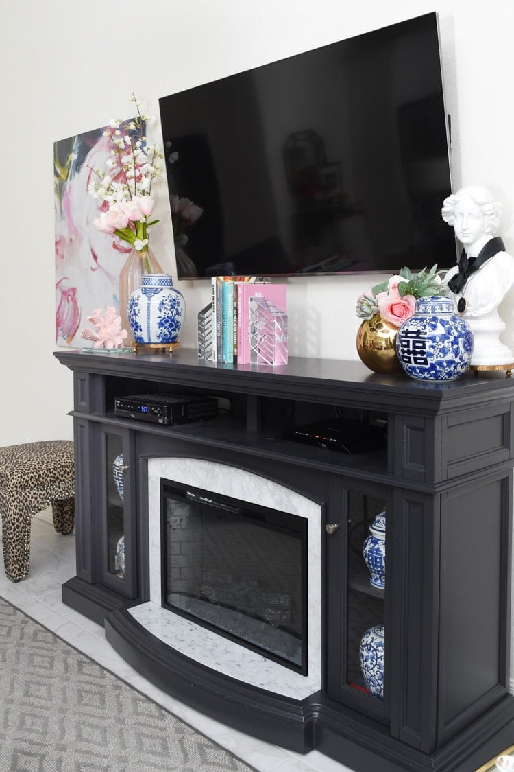 How to decorate for spring around a TV fireplace