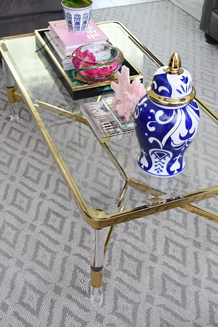 Brass, glass and lucite living room coffee table decor ideas