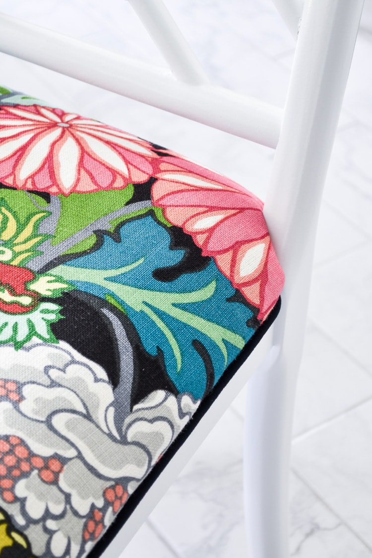 Schumacher Chiang Mai Dragon in Ebony dining chair cushions with white fretwork chairs
