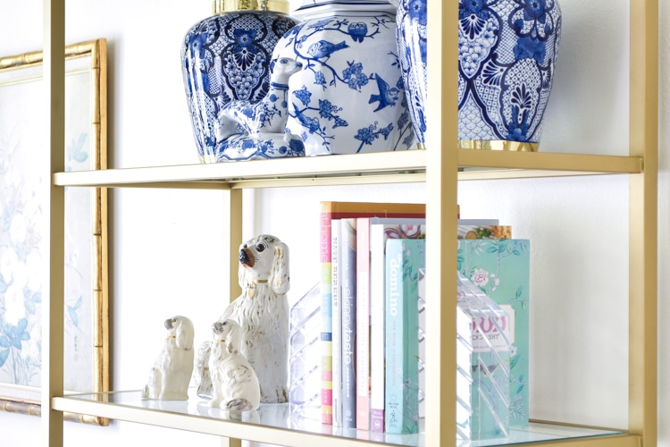 Chinoiserie staffordshire dogs and ginger jars on a bookshelf in a dining room