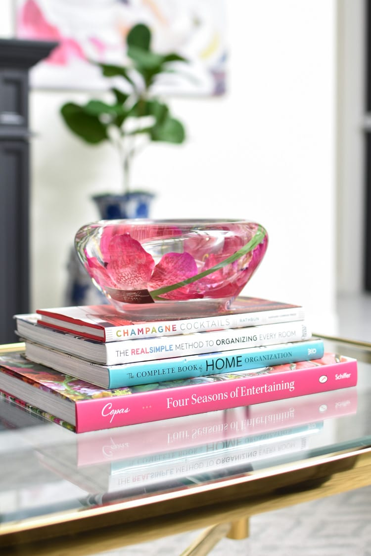 Glass flower bowl on a stack of books