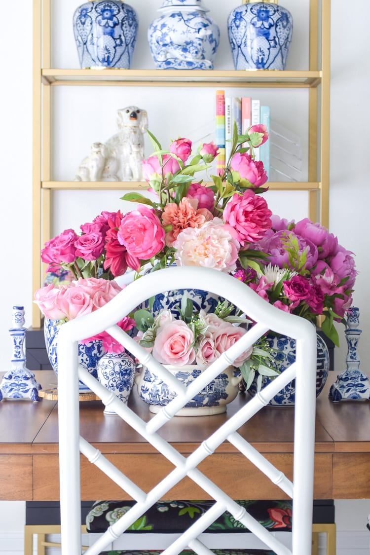 Ginger jars with peonies on a dining table for a centerpiece