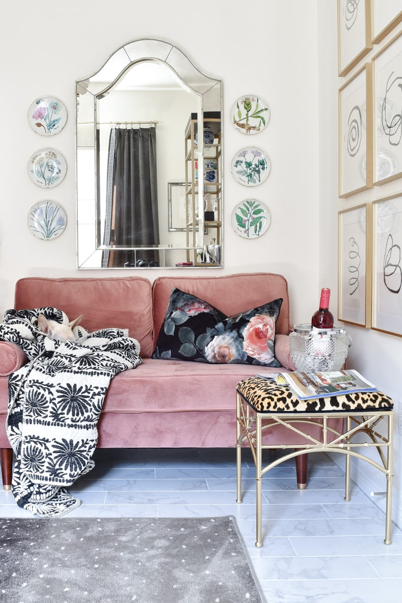 Pink clovis loveseat, burl wood nightstand table, leopard and gold bamboo ottoman and other vintage items adorn this beautiful home office space.