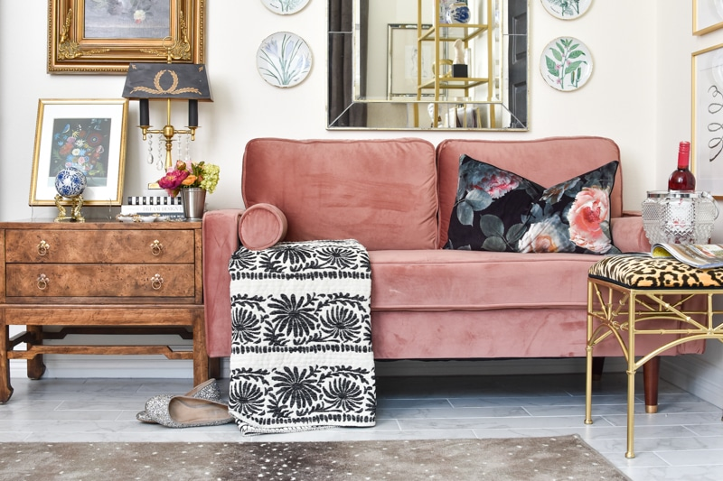 Blush pink velvet loveseat and burl wood chest in a home office makeover