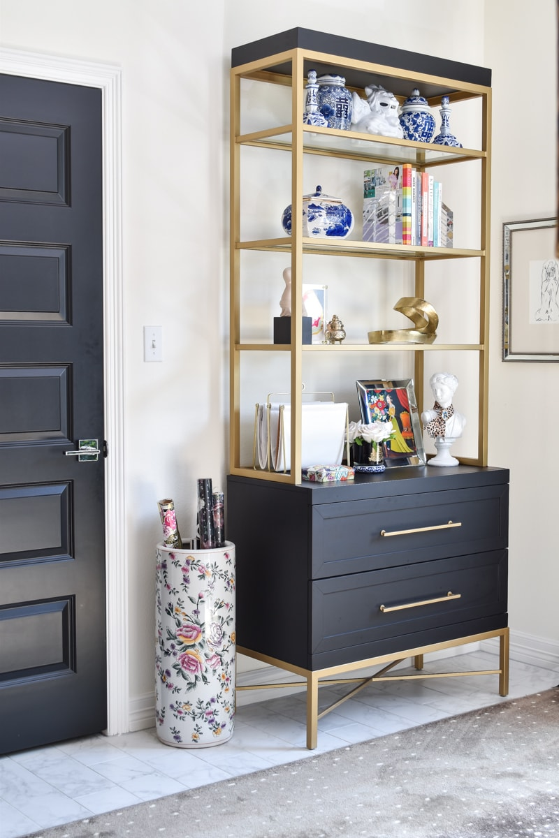 Black and gold etagere in a home office space