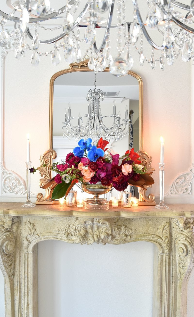 Dutch style florals in front of a gilded mirror in a fall home tour.