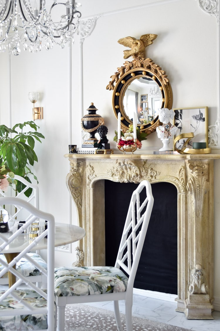 French Dining Room with faux fireplace, fretwork dining chairs and floral fabric