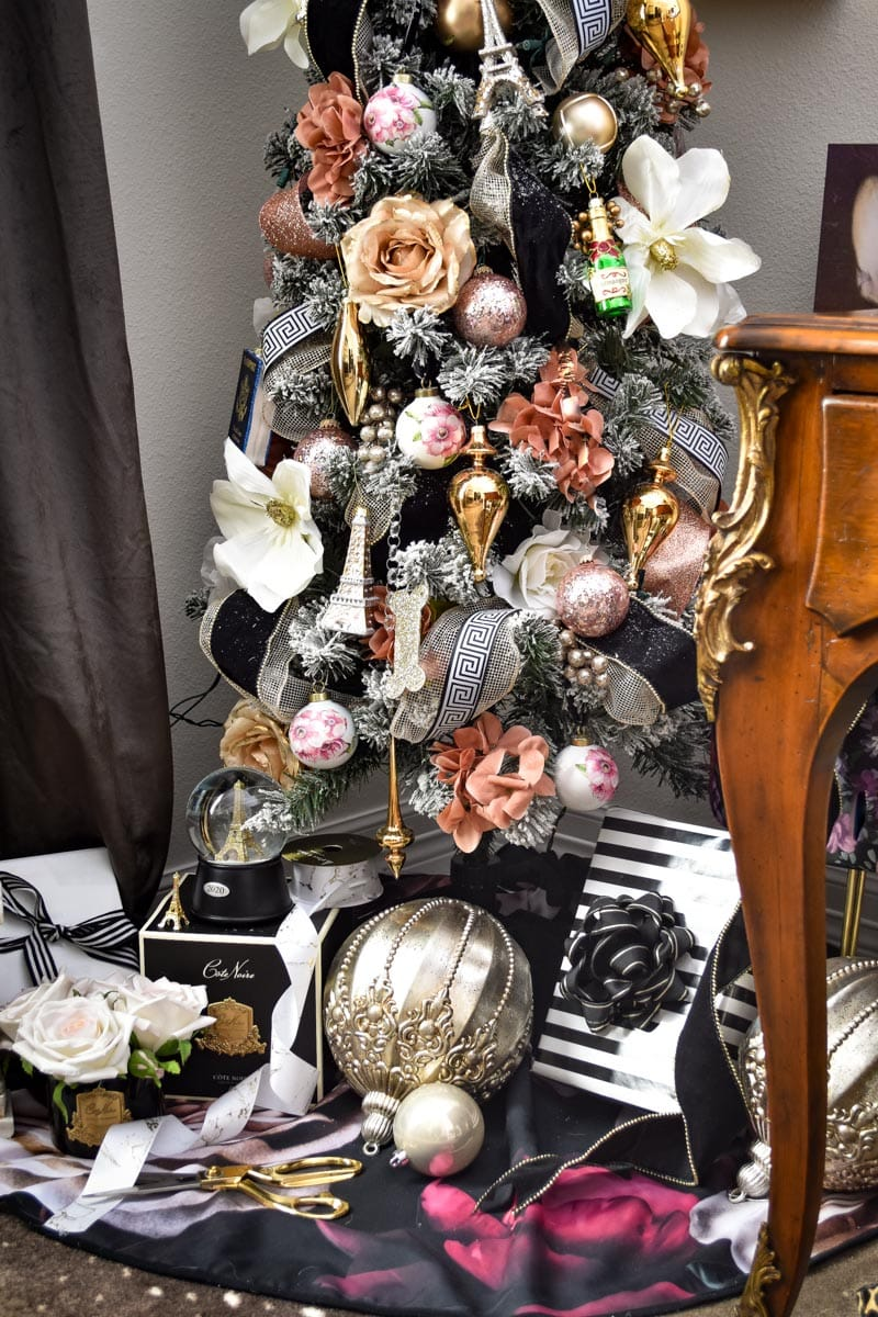 A Parisian inspired pink and gold Christmas tree with lots of flowers