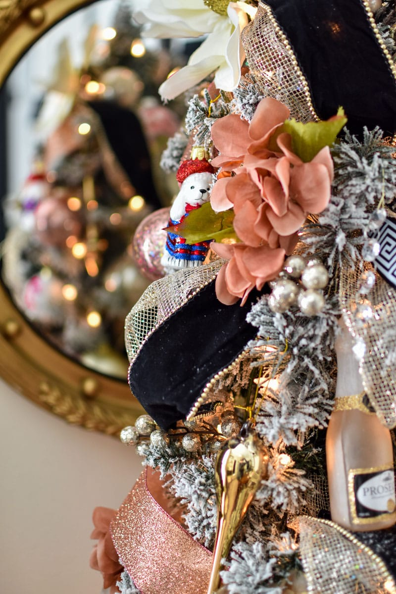 Pink and gold floral Christmas tree with black velvet ribbon in a French inspired home office